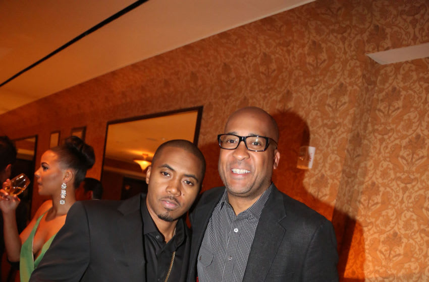 NEW YORK, NY - JUNE 02: (L-R) Nas and William 'World Wide Wes' Wesley attend Carmelo Anthony's '30 for 30' Birthday Dinner at The NoMad Hotel on June 2, 2014 in New York City. (Photo by Johnny Nunez/Getty Images for Haute Living)