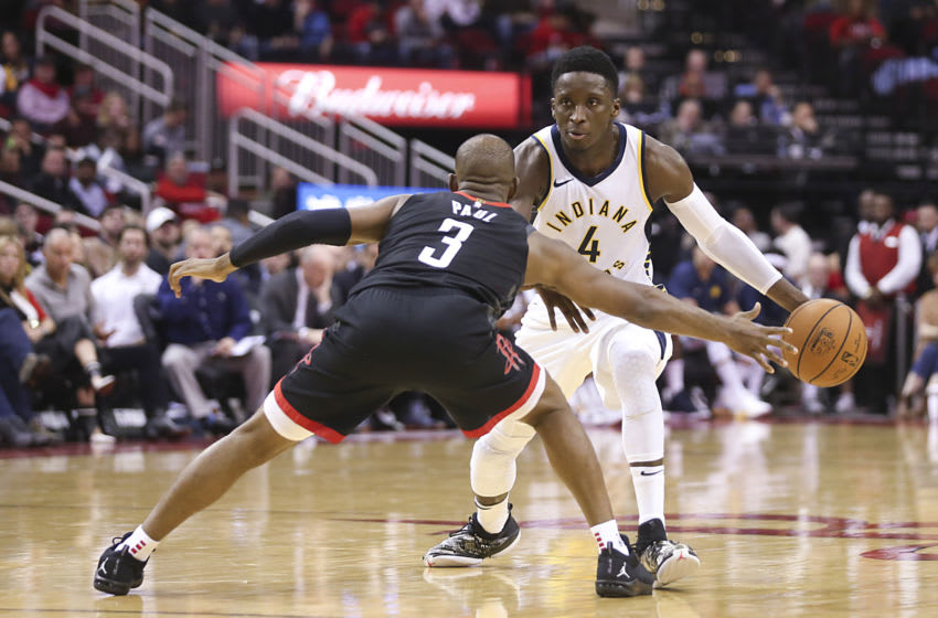 Nov 11, 2018; Houston, TX, USA; Indiana Pacers guard Victor Oladipo (4) dribbles against Houston Rockets guard Chris Paul (3) in the second half at Toyota Center. Mandatory Credit: Thomas B. Shea-USA TODAY Sports