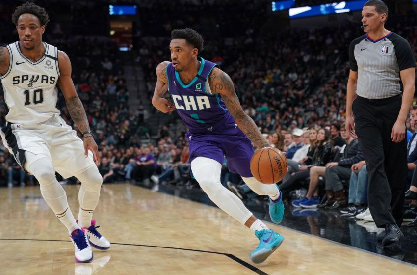 Feb 1, 2020; San Antonio, Texas, USA; Charlotte Hornets guard Malik Monk (1) drives past San Antonio Spurs forward DeMar DeRozan (10) in the second half at the AT&T Center. Mandatory Credit: Daniel Dunn-USA TODAY Sports