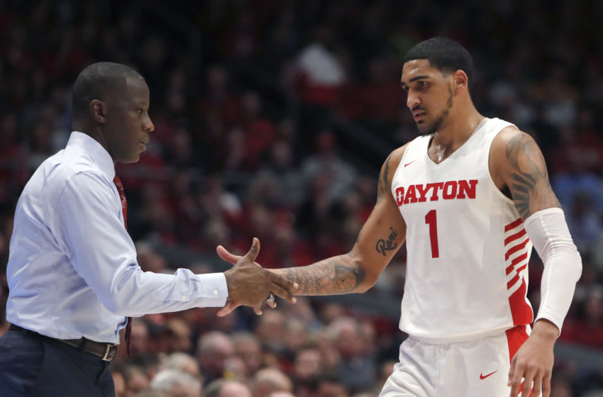 Feb 28, 2020; Dayton, Ohio, USA; Dayton Flyers head coach Anthony Grant (left) reacts with forward Obi Toppin (1) during the second half against the Davidson Wildcats at University of Dayton Arena. Mandatory Credit: David Kohl-USA TODAY Sports