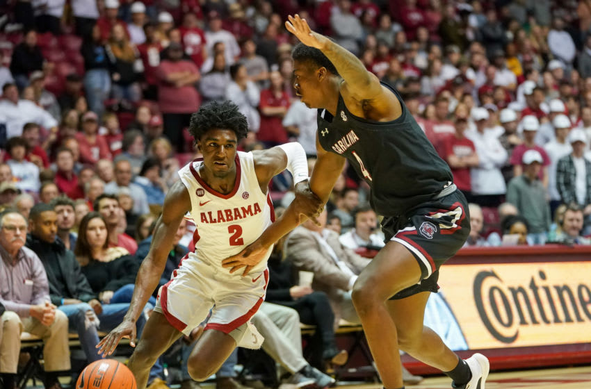 Feb 29, 2020; Tuscaloosa, Alabama, USA; Alabama Crimson Tide guard Kira Lewis Jr. (2) drives to the basket against South Carolina Gamecocks forward Jalyn McCreary (4) during the second half at Coleman Coliseum. Mandatory Credit: Marvin Gentry-USA TODAY Sports