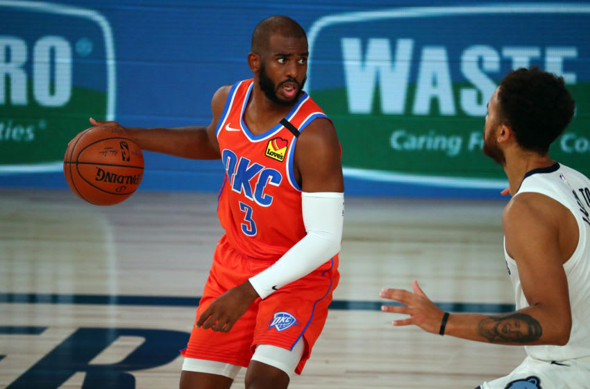 August 7, 2020; Lake Buena Vista, Florida, USA; Oklahoma City Thunder guard Chris Paul (3) controls the ball against Memphis Grizzlies forward Kyle Anderson (1) during the first half of an NBA game at Visa Athletic Center. Mandatory Credit: Kim Klement-USA TODAY Sports