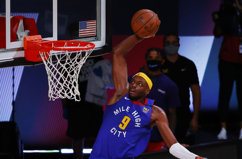 Aug 8, 2020; Lake Buena Vista, Florida, USA; Jerami Grant #9 of the Denver Nuggets with a slam dunk over Utah Jazz during double overtime at AdventHealth Arena. Mandatory Credit: Kevin C. Cox/Pool Photo-USA TODAY Sports