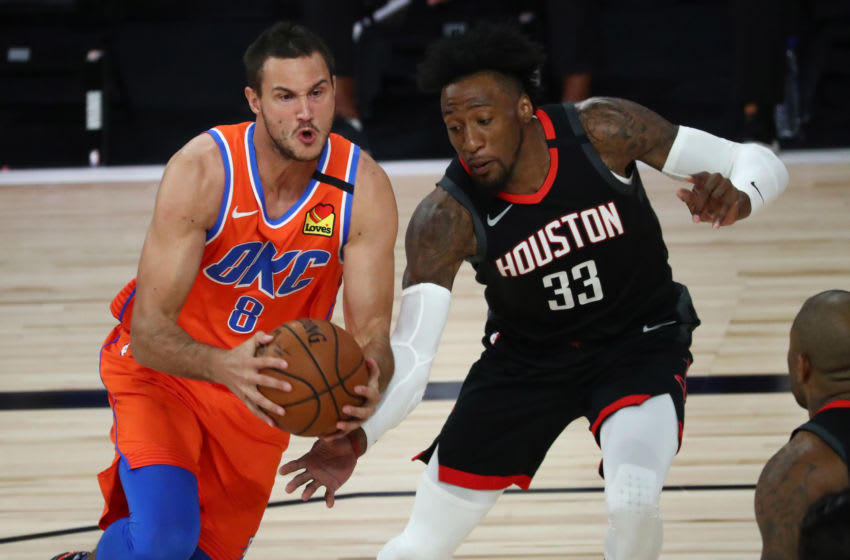 Aug 18, 2020; Lake Buena Vista, Florida, USA; Oklahoma City Thunder forward Danilo Gallinari (8) drives against Houston Rockets forward Robert Covington (33) in the first half in game one of the first round of the 2020 NBA Playoffs at The Field House. Mandatory Credit: Kim Klement-USA TODAY Sports