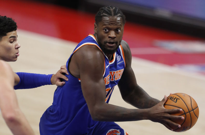 Dec 13, 2020; Detroit, Michigan, USA; New York Knicks forward Julius Randle (30) gets defended by Detroit Pistons guard Killian Hayes (7) during the first quarter at Little Caesars Arena. Mandatory Credit: Raj Mehta-USA TODAY Sports