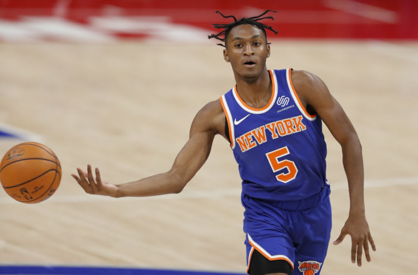 Dec 13, 2020; Detroit, Michigan, USA; New York Knicks guard Immanuel Quickley (5) passes the ball during the second quarter against the Detroit Pistons at Little Caesars Arena. Mandatory Credit: Raj Mehta-USA TODAY Sports