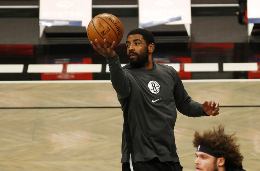Jan 5, 2021; Brooklyn, New York, USA; Brooklyn Nets guard Kyrie Irving (11) warms up prior to a game against the Utah Jazz at Barclays Center. Mandatory Credit: Andy Marlin-USA TODAY Sports