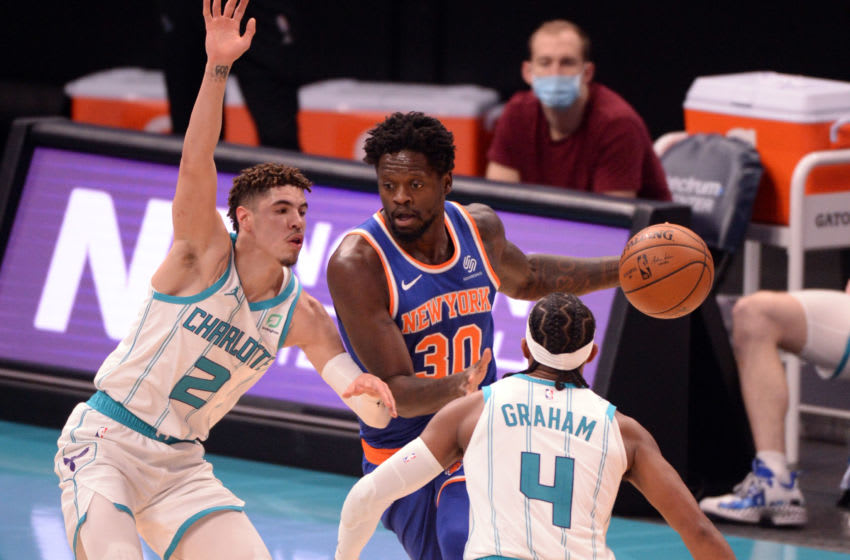 Jan 11, 2021; Charlotte, North Carolina, USA; New York Knicks forward center Julius Randle (30) dribbles the ball while defended by Charlotte Hornets guard LaMelo Ball (2) and guard DevonteÕ Graham (4) during the second half at the Spectrum Center. Mandatory Credit: Sam Sharpe-USA TODAY Sports