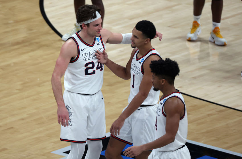 Mar 20, 2021; Indianapolis, Indiana, USA; Gonzaga Bulldogs forward Corey Kispert (24) embraces guard Jalen Suggs (1) during the second half against the Norfolk State Spartans in the first round of the 2021 NCAA Tournament at Bankers Life Fieldhouse. Mandatory Credit: Trevor Ruszkowski-USA TODAY Sports