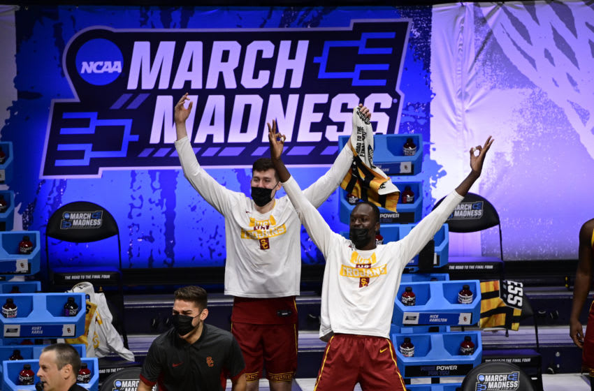 Mar 22, 2021; Indianapolis, Indiana, USA; The Southern California Trojans bench reacts during the second half in the second round of the 2021 NCAA Tournament against the Kansas Jayhawks at Hinkle Fieldhouse. Mandatory Credit: Marc Lebryk-USA TODAY Sports