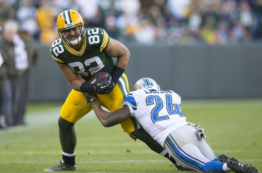 Nov 15, 2015; Green Bay, WI, USA; Green Bay Packers tight end Richard Rodgers (82) is tackled by Detroit Lions cornerback Nevin Lawson (24) during the fourth quarter at Lambeau Field. Detroit won 18-16. Mandatory Credit: Jeff Hanisch-USA TODAY Sports