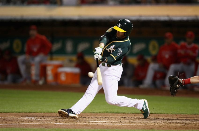 OAKLAND, CA - SEPTEMBER 19: Jed Lowrie #8 of the Oakland Athletics hits a double the scores two runs in the fourth inning against the Los Angeles Angels at Oakland Alameda Coliseum on September 19, 2018 in Oakland, California. (Photo by Ezra Shaw/Getty Images)
