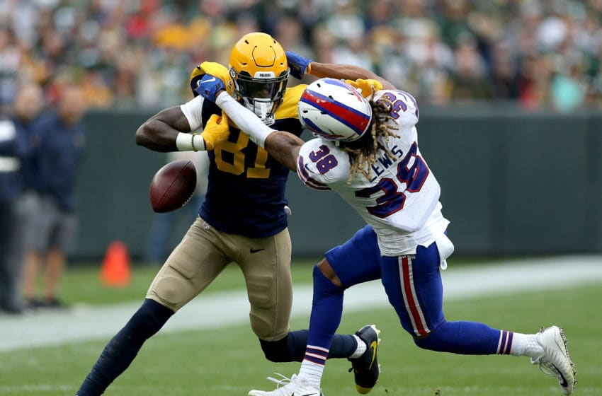 GREEN BAY, WI - SEPTEMBER 30: Ryan Lewis #38 of the Buffalo Bills forces a fumble against Geronimo Allison #81 of the Green Bay Packers during the second quarter of a game at Lambeau Field on September 30, 2018 in Green Bay, Wisconsin. (Photo by Dylan Buell/Getty Images)