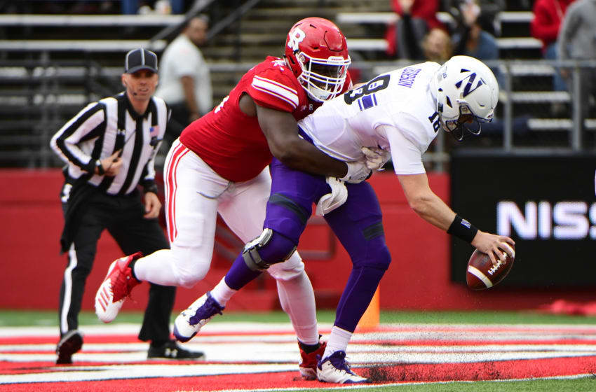PISCATAWAY, NJ - OCTOBER 20: Willington Previlon #96 of the Rutgers Scarlet Knights sacks Clayton Thorson #18 of the Northwestern Wildcats and scores a safety during the second quarter on October 20, 2018 in Piscataway, New Jersey. (Photo by Corey Perrine/Getty Images)