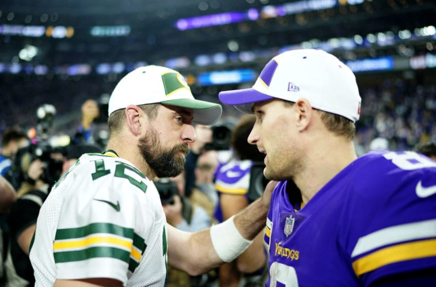 MINNEAPOLIS, MN - NOVEMBER 25: Aaron Rodgers #12 of the Green Bay Packers and Kirk Cousins #8 of the Minnesota Vikings greet each other after the game at U.S. Bank Stadium on November 25, 2018 in Minneapolis, Minnesota. The Vikings defeated the Packers 24-17. (Photo by Hannah Foslien/Getty Images)
