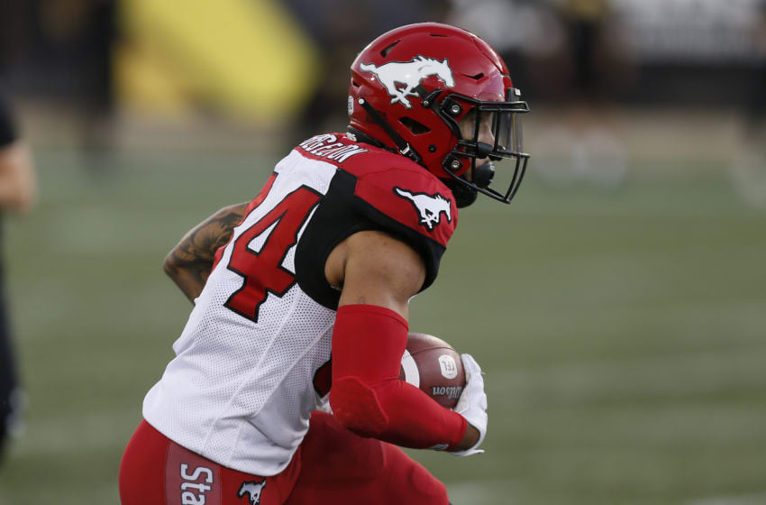 HAMILTON, ON - JULY 13: Reggie Begelton #84 of the Calgary Stampeders gains yards after a catch against the Hamilton Tiger-Cats at Tim Hortons Field on July 13, 2019 in Hamilton, Canada. Hamilton defeated Calgary 30-23. (Photo by John E. Sokolowski/Getty Images)