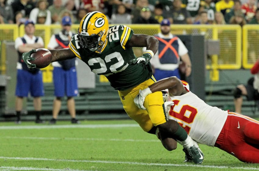 GREEN BAY, WISCONSIN - AUGUST 29: Dexter Williams #22 of the Green Bay Packers scores a touchdown past Raymond Davison #46 of the Kansas City Chiefs in the fourth quarter during a preseason game at Lambeau Field on August 29, 2019 in Green Bay, Wisconsin. (Photo by Dylan Buell/Getty Images)