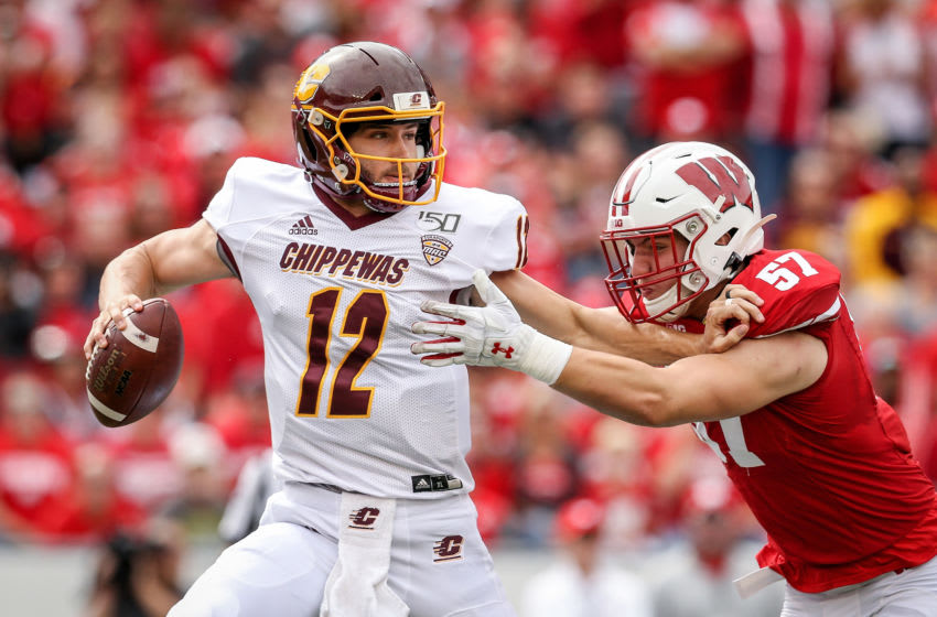 MADISON, WISCONSIN - SEPTEMBER 07: Jack Sanborn #57 of the Wisconsin Badgers sacks Quinten Dormady #12 of the Central Michigan Chippewas in the first quarter at Camp Randall Stadium on September 07, 2019 in Madison, Wisconsin. (Photo by Dylan Buell/Getty Images)