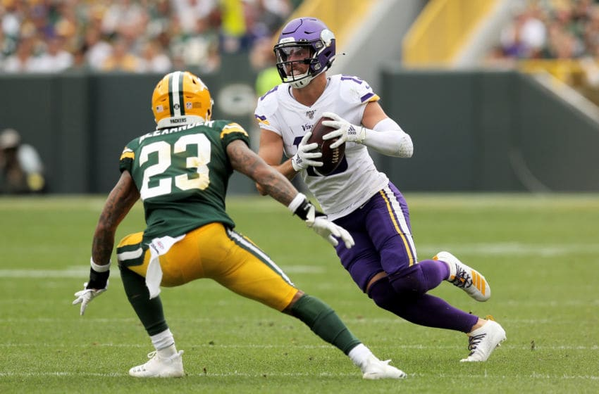 GREEN BAY, WISCONSIN - SEPTEMBER 15: Adam Thielen #19 of the Minnesota Vikings runs with the ball against Jaire Alexander #23 of the Green Bay Packers in the third quarter at Lambeau Field on September 15, 2019 in Green Bay, Wisconsin. (Photo by Dylan Buell/Getty Images)