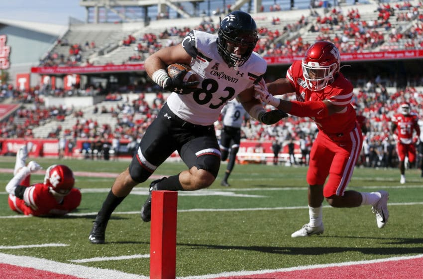 HOUSTON, TX - OCTOBER 12: Josiah Deguara #83 of the Cincinnati Bearcats catches a pass for a touchdown defended by Deontay Anderson #2 of the Houston Cougars in the second quarter at TDECU Stadium on October 12, 2019 in Houston, Texas. (Photo by Tim Warner/Getty Images)