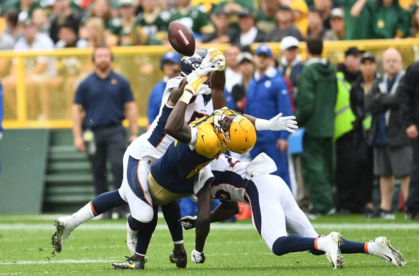 GREEN BAY, WISCONSIN - SEPTEMBER 22: Todd Davis #51 of the Denver Broncos defends a pass intended for Geronimo Allison #81 of the Green Bay Packers during the first half at Lambeau Field on September 22, 2019 in Green Bay, Wisconsin. (Photo by Stacy Revere/Getty Images)