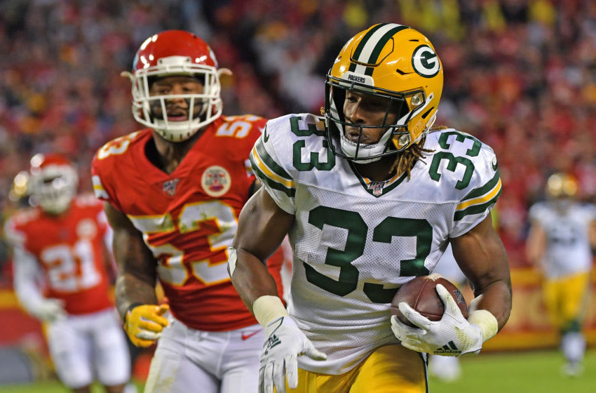 KANSAS CITY, MO - OCTOBER 27: Running back Aaron Jones #33 of the Green Bay Packers runs up field after catching a pass against inside linebacker Anthony Hitchens #53 of the Kansas City Chiefs during the first quarter at Arrowhead Stadium on October 27, 2019 in Kansas City, Missouri. (Photo by Peter Aiken/Getty Images)