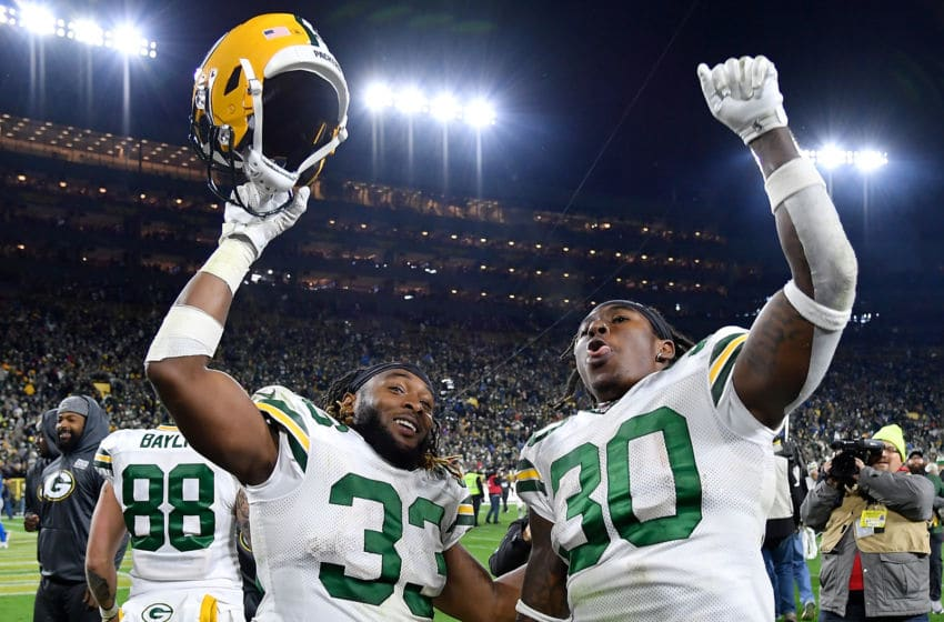 GREEN BAY, WISCONSIN - OCTOBER 14: Aaron Jones #33 and Jamaal Williams #30 of the Green Bay Packers celebrate the win against the Detroit Lions at Lambeau Field on October 14, 2019 in Green Bay, Wisconsin. (Photo by Quinn Harris/Getty Images)
