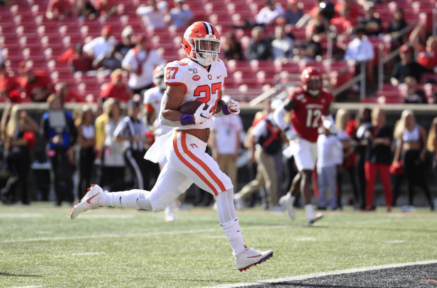 LOUISVILLE, KENTUCKY - OCTOBER 19: Chez Mellusi #27 of the Clemson Tigers runs for a touchdown against the Louisville Cardinals at Cardinal Stadium on October 19, 2019 in Louisville, Kentucky. (Photo by Andy Lyons/Getty Images)