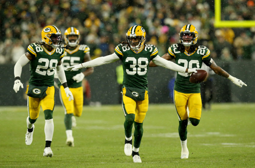 GREEN BAY, WISCONSIN - NOVEMBER 10: Tramon Williams #38 of the Green Bay Packers celebrates with his teammates after an interception against Kyle Allen #7 of the Carolina Panthers during the third quarter in the game at Lambeau Field on November 10, 2019 in Green Bay, Wisconsin. (Photo by Dylan Buell/Getty Images)