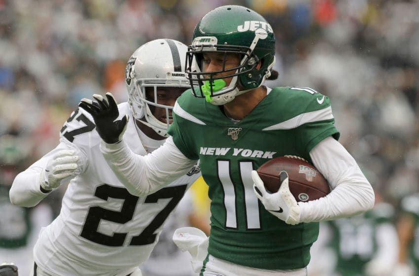 EAST RUTHERFORD, NEW JERSEY - NOVEMBER 24: (NEW YORK DAILIES OUT) Robby Anderson #11 of the New York Jets in action against Trayvon Mullen #27 of the Oakland Raiders at MetLife Stadium on November 24, 2019 in East Rutherford, New Jersey. The Jets defeated the Raiders 34-3. (Photo by Jim McIsaac/Getty Images)