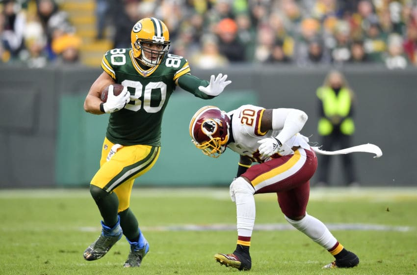 GREEN BAY, WISCONSIN - DECEMBER 08: Jimmy Graham #80 of the Green Bay Packers runs with the football against Landon Collins #20 of the Washington Redskins at Lambeau Field on December 08, 2019 in Green Bay, Wisconsin. (Photo by Quinn Harris/Getty Images)