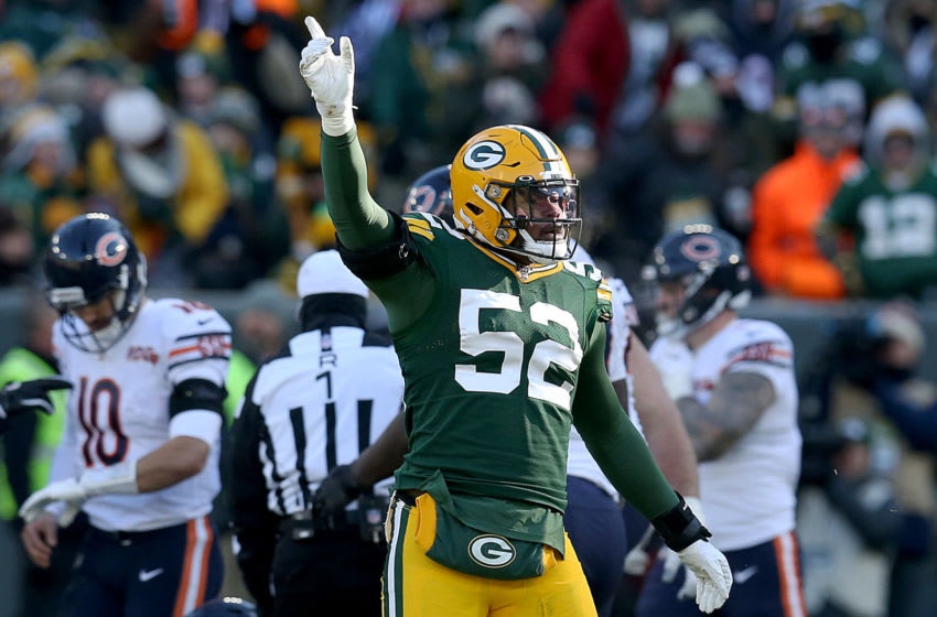 GREEN BAY, WISCONSIN - DECEMBER 15: Linebacker Rashan Gary #52 of the Green Bay Packers celebrates after a tackle against the Chicago Bears during the game at Lambeau Field on December 15, 2019 in Green Bay, Wisconsin. (Photo by Dylan Buell/Getty Images)
