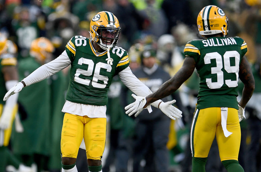 GREEN BAY, WISCONSIN - DECEMBER 15: Free safety Darnell Savage #26 of the Green Bay Packers and defensive back Chandon Sullivan #39 celebrate a play during the game against the Chicago Bears at Lambeau Field on December 15, 2019 in Green Bay, Wisconsin. (Photo by Stacy Revere/Getty Images)