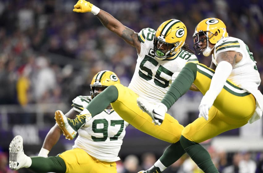 MINNEAPOLIS, MINNESOTA - DECEMBER 23: Outside linebacker Za'Darius Smith #55 of the Green Bay Packers and linebacker Kyler Fackrell #51 of the Green Bay Packers celebrate after a sack against the Minnesota Vikings during the game at U.S. Bank Stadium on December 23, 2019 in Minneapolis, Minnesota. (Photo by Hannah Foslien/Getty Images)