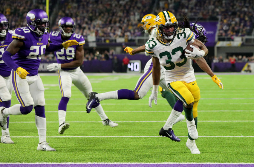 MINNEAPOLIS, MINNESOTA - DECEMBER 23: Running back Aaron Jones #33 of the Green Bay Packers rushes for a touchdown in the third quarter of the game against the Minnesota Vikings at U.S. Bank Stadium on December 23, 2019 in Minneapolis, Minnesota. (Photo by Adam Bettcher/Getty Images)