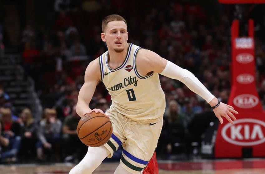 CHICAGO, ILLINOIS - DECEMBER 30: Donte DiVincenzo #0 of the Milwaukee Bucks brings the ball up the court against the Chicago Bulls at the United Center on December 30, 2019 in Chicago, Illinois. The Bucks defeated the Bulls 123-102. NOTE TO USER: User expressly acknowledges and agrees that , by downloading and or using this photograph, User is consenting to the terms and conditions of the Getty Images License Agreement. (Photo by Jonathan Daniel/Getty Images)