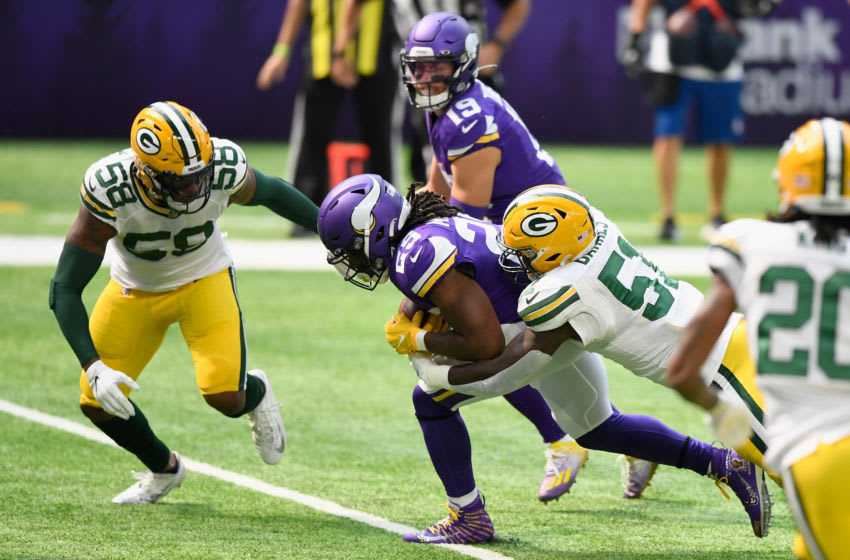MINNEAPOLIS, MINNESOTA - SEPTEMBER 13: Alexander Mattison #25 of the Minnesota Vikings is tackled by Krys Barnes #51 of the Green Bay Packers during the first quarter of the game at U.S. Bank Stadium on September 13, 2020 in Minneapolis, Minnesota. (Photo by Hannah Foslien/Getty Images)