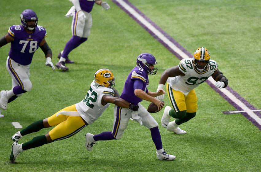 MINNEAPOLIS, MINNESOTA - SEPTEMBER 13: Rashan Gary #52 and Kenny Clark #97 of the Green Bay Packers tackle quarterback Kirk Cousins #8 of the Minnesota Vikings as he scrambles out of the pocket during the second quarter of the game at U.S. Bank Stadium on September 13, 2020 in Minneapolis, Minnesota. (Photo by Hannah Foslien/Getty Images)