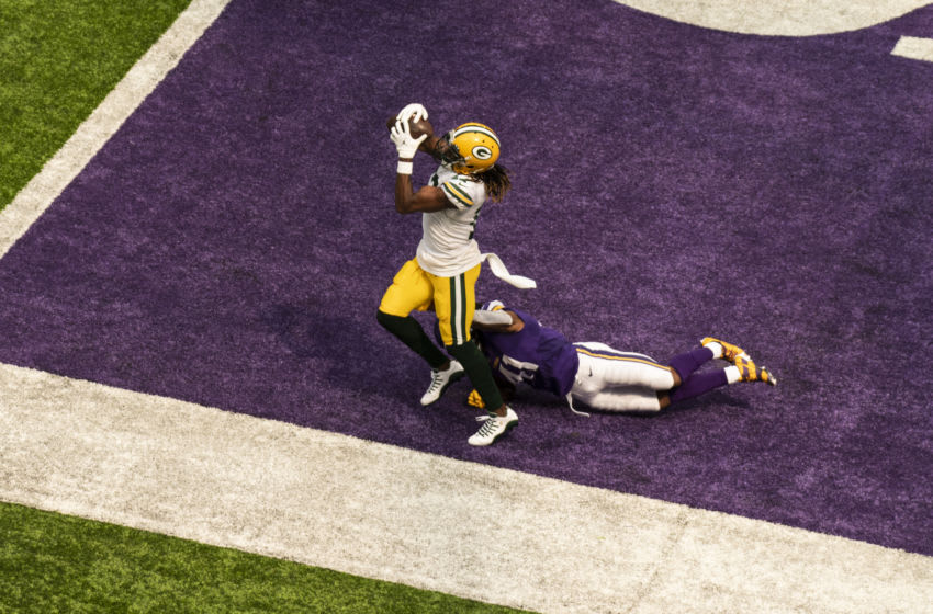 MINNEAPOLIS, MN - SEPTEMBER 13: Davante Adams #17 of the Green Bay Packers catches the ball for a touchdown over defender Anthony Harris #41 of the Minnesota Vikings in the second quarter of the game at U.S. Bank Stadium on September 13, 2020 in Minneapolis, Minnesota. (Photo by Stephen Maturen/Getty Images)