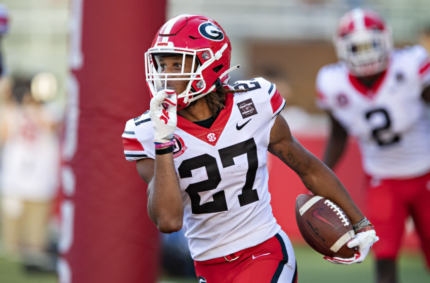 FAYETTEVILLE, AR - SEPTEMBER 26: Eric Stokes #27 of the Georgia Bulldogs signals to his teammates after returning an interception for a touchdown in the second half of a game against the Arkansas Razorbacks at Razorback Stadium on September 26, 2020 in Fayetteville, Arkansas The Bulldogs defeated the Razorbacks 37-10. (Photo by Wesley Hitt/Getty Images)
