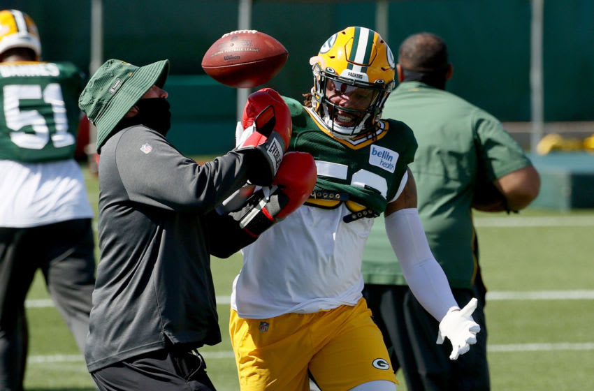 ASHWAUBENON, WISCONSIN - AUGUST 19: Christian Kirksey #58 of the Green Bay Packers participates in a drill during Green Bay Packers Training Camp at Ray Nitschke Field on August 19, 2020 in Ashwaubenon, Wisconsin. (Photo by Dylan Buell/Getty Images)