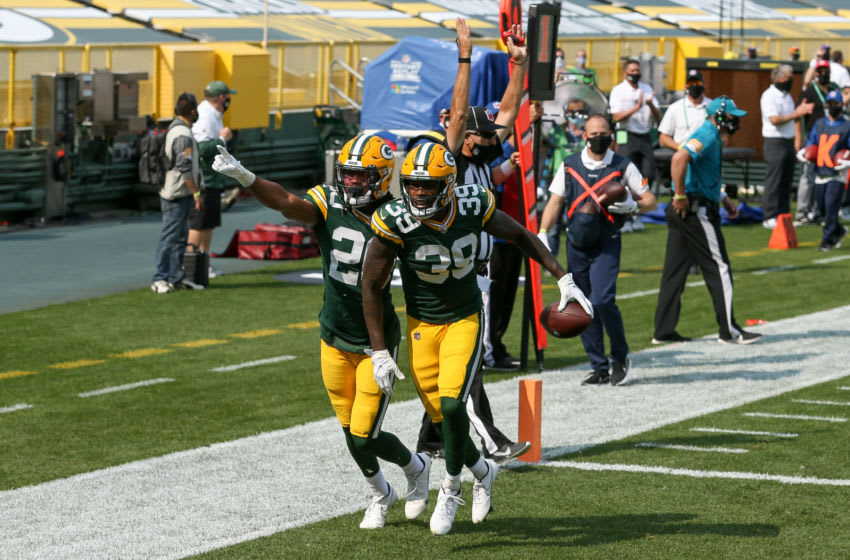 GREEN BAY, WISCONSIN - SEPTEMBER 20: Kevin King #20 and Chandon Sullivan #39 of the Green Bay Packers celebrate after Sullivan scored a touchdown in the third quarter against the Detroit Lions at Lambeau Field on September 20, 2020 in Green Bay, Wisconsin. (Photo by Dylan Buell/Getty Images)
