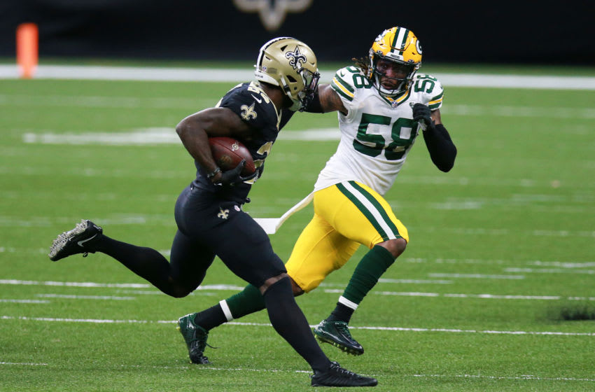 NEW ORLEANS, LOUISIANA - SEPTEMBER 27: Latavius Murray #28 of the New Orleans Saints is pursued by Christian Kirksey #58 of the Green Bay Packers during the first half at Mercedes-Benz Superdome on September 27, 2020 in New Orleans, Louisiana. (Photo by Sean Gardner/Getty Images)