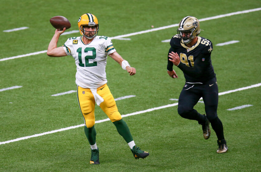 NEW ORLEANS, LOUISIANA - SEPTEMBER 27: Aaron Rodgers #12 of the Green Bay Packers attempts a pass under pressure from Trey Hendrickson #91 of the New Orleans Saints during the second half at Mercedes-Benz Superdome on September 27, 2020 in New Orleans, Louisiana. (Photo by Sean Gardner/Getty Images)