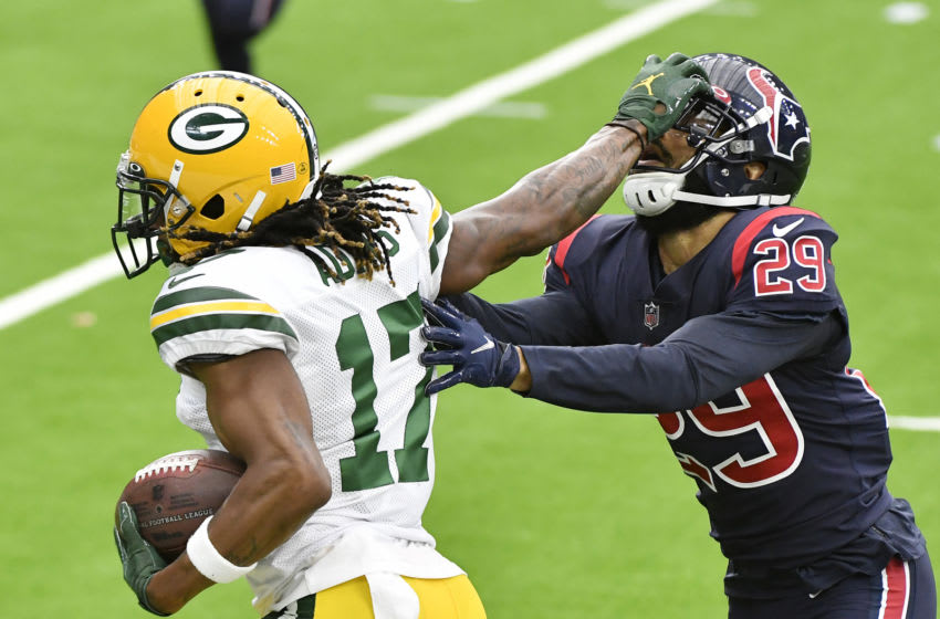 HOUSTON, TEXAS - OCTOBER 25: Davante Adams #17 of the Green Bay Packers stiff arms Phillip Gaines #29 of the Houston Texans during the second quarter at NRG Stadium on October 25, 2020 in Houston, Texas. (Photo by Logan Riely/Getty Images)