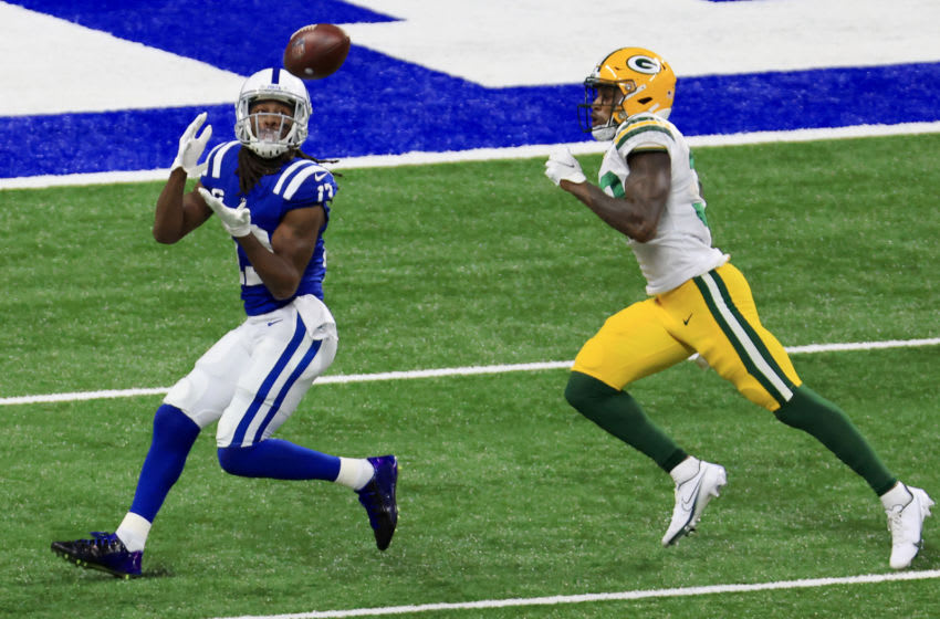 INDIANAPOLIS, INDIANA - NOVEMBER 22: T.Y. Hilton #13 of the Indianapolis Colts catches a first down pass against Chandon Sullivan #39 of the Green Bay Packers during the third quarter in the game at Lucas Oil Stadium on November 22, 2020 in Indianapolis, Indiana. (Photo by Justin Casterline/Getty Images)