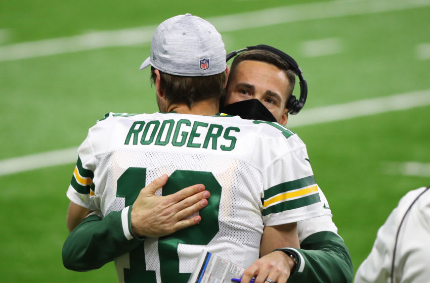 DETROIT, MICHIGAN - DECEMBER 13: Head coach Matt LaFleur of the Green Bay Packers hugs Aaron Rodgers #12 before their game against the Detroit Lions at Ford Field on December 13, 2020 in Detroit, Michigan. (Photo by Rey Del Rio/Getty Images)