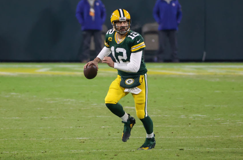 GREEN BAY, WISCONSIN - DECEMBER 19: Aaron Rodgers #12 of the Green Bay Packers drops back to pass in the second quarter against the Carolina Panthers at Lambeau Field on December 19, 2020 in Green Bay, Wisconsin. (Photo by Dylan Buell/Getty Images)