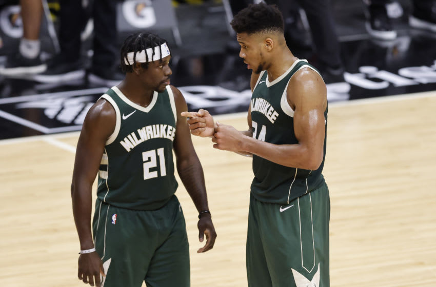 MIAMI, FLORIDA - DECEMBER 30: Jrue Holiday #21 and Giannis Antetokounmpo #34 of the Milwaukee Bucks talk against the Miami Heat during the third quarter at American Airlines Arena on December 30, 2020 in Miami, Florida. NOTE TO USER: User expressly acknowledges and agrees that, by downloading and or using this photograph, User is consenting to the terms and conditions of the Getty Images License Agreement. (Photo by Michael Reaves/Getty Images)