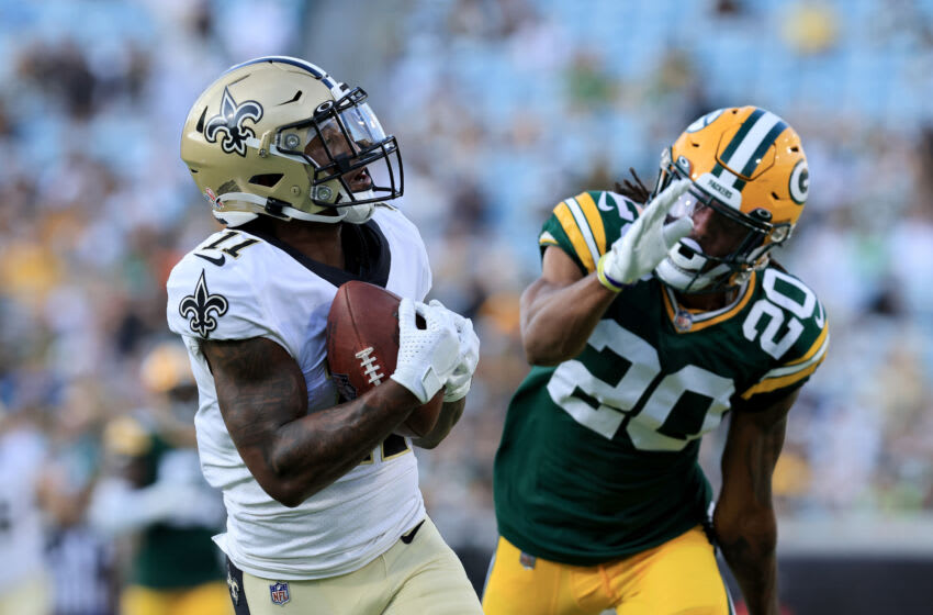 JACKSONVILLE, FLORIDA - SEPTEMBER 12: Deonte Harris #11 of the New Orleans Saints makes a reception for a touchdown against Kevin King #20 of the Green Bay Packers during the game at TIAA Bank Field on September 12, 2021 in Jacksonville, Florida. (Photo by Sam Greenwood/Getty Images)